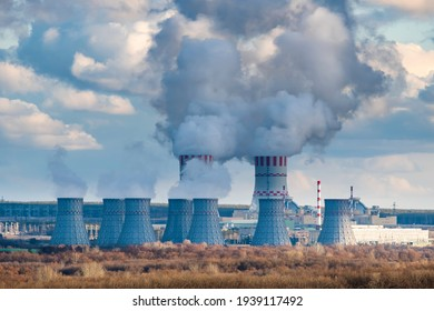 Nuclear power plant with Cooling tower with steam of Atomic power station. Industrial zone of nuclear with emission of steam in the air atmosphere