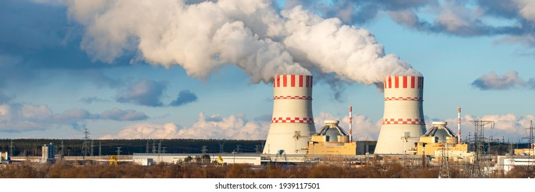 Nuclear power plant with Cooling tower with steam of Atomic power station. Industrial zone of nuclear with emission of steam in the air atmosphere. Wide banner