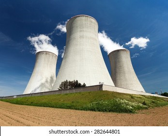 Nuclear power plant Dukovany - cooling towers, field and beautiful sky - Czech Republic