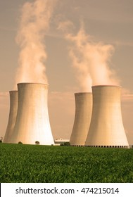 Nuclear power plant. Giant cooling towers with vapor. Nuclear power production concept.