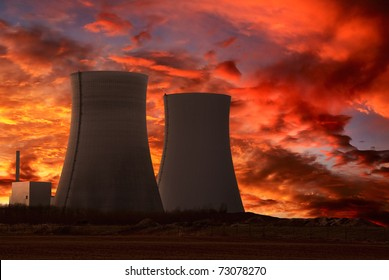 Nuclear power plant with an intense red and cloudy evening sky