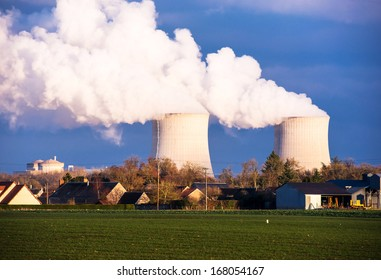A nuclear power plant located in the countryside close to homes