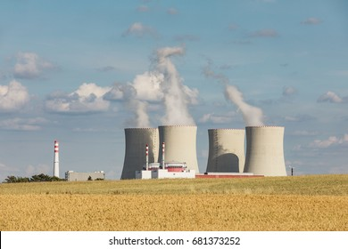 Nuclear power plant Temelin in the Czech Republic. Dusk landscape with big chimneys.