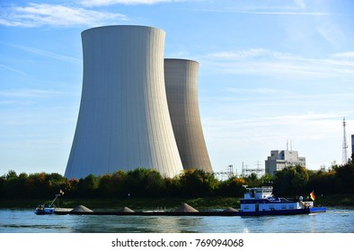 Nuclear Power Plant with two cooling towers near river Rhein on sunny day, Germany