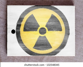 Nuclear radiation symbol painted on painted over wooden board