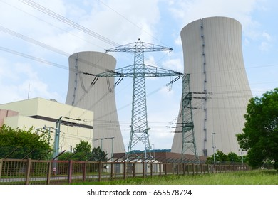 Nuclear reactor, cooling towers and electricity masts of Nuclear power plant (NPP) Grohnde, district Hameln, Lower Saxony, Germany