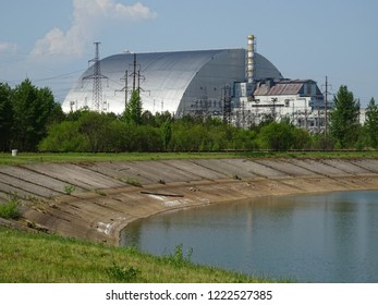 nuclear reactors of Chernobyl power plant next to Pripyat river, 4th (exploded) reactor with sarcophagus on left, 3th reactor on right, Exclusion zone, Ukraine, Eastern Europe