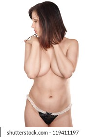 Nude attractive brunette on the white background.