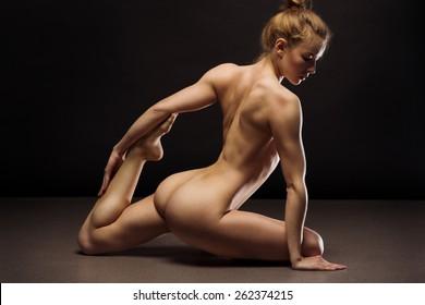 Nude beautiful lady sitting on black background