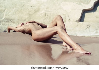 nude beautiful woman on the nudist beach.  Summer paradise.