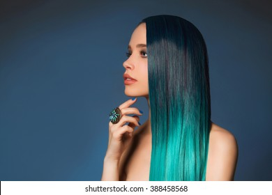 nude beautiful young woman with jewelry ring. sexy girl with long blue hair