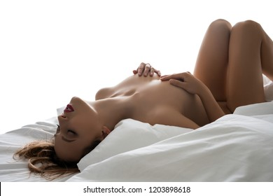 Nude blonde in bed isolated cropped shot