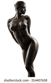 Nude body of the beautiful woman. Filtered to black. Isolated on white background.