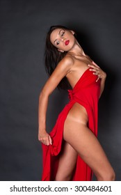 Nude body covered with a red fabric