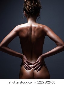 nude body girl. Naked woman back in dark. Beautiful Female Spine