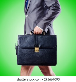 Nude businessman with briefcase against gradient