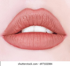 Nude color lipstick on mouth