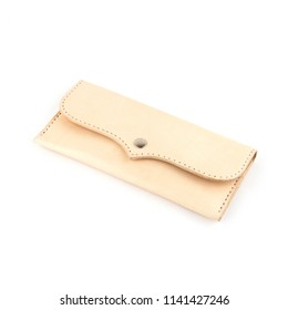 A nude coloured vegetable tanned leather wallet on a white background