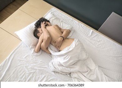 Nude couple having sex in bed