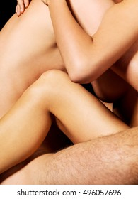 Nude couple in passionate embrace