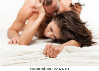 Nude couple. Passionate couple kissing, boy and girl. Having sex. Young lovers. People in love. Positions kamasutra. Erotic moments. Concept photo. Secret. Fashion. Hot babe. Party. Sensual. Love.