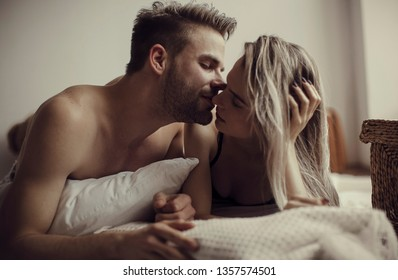 Nude couple. Passionate couple kissing, boy and girl. Having sex. Young lovers. People in love. Positions kamasutra. Erotic moments. Concept photo. Secret. Fashion. Hot babe. Party.