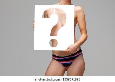 nude female body behind stencil question mark character