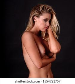 Nude figure study of sensual beautiful woman with perfect body posing nude