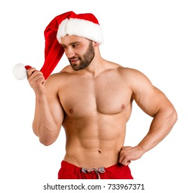 Nude fit Santa Claus with muscular torso isolated on a white background. New year 2018 concept.