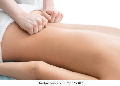 Nude girl being massaged cropped view