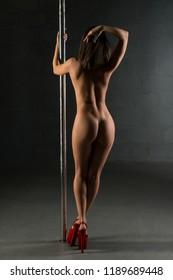 Nude girl dancing on pylon rearview