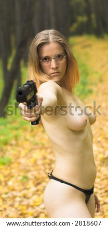 Nude Girl With Gun In The Autumn Forest