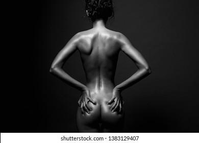 nude girl in studio. Naked woman back in dark. Beautiful Female Back