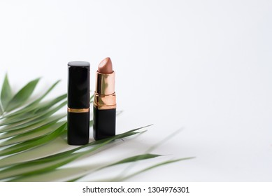 nude lipstic on white background top view . cosmetics