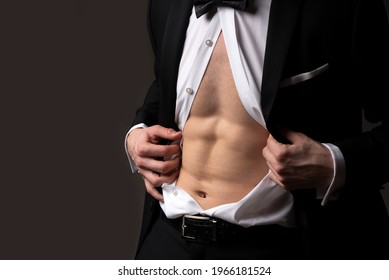 Nude male abs in black suit. Retro fashion. Formal classic suit. Elegant fashion.