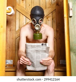 Nude man in gas-mask sitting in stinky toilet in Finland
