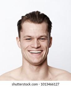 Nude man smiling