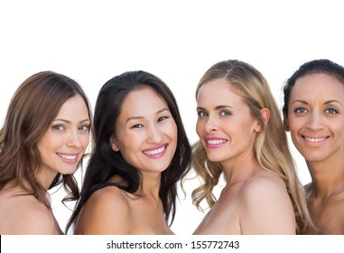Nude models posing and looking at camera on white background