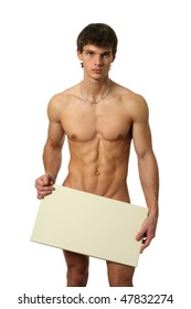 Nude muscular man covering with a copy space blank board isolated on white