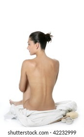 Nude sit woman back with white towel studio shot