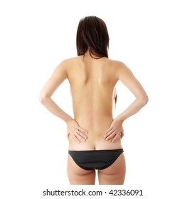 Nude woman from behind. Back pain concept. Isolated