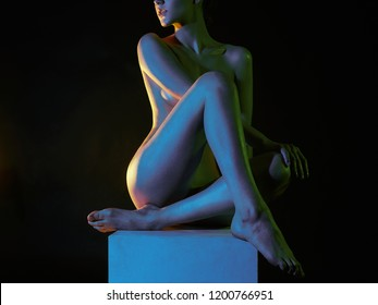 Nude Woman in Colorful bright lights. rainbow shiny Naked body of Girl
