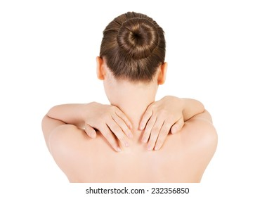 Nude woman having back pain stretching.