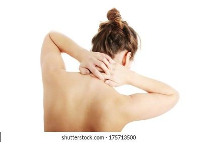 Nude woman with neck pain , isolated on white background