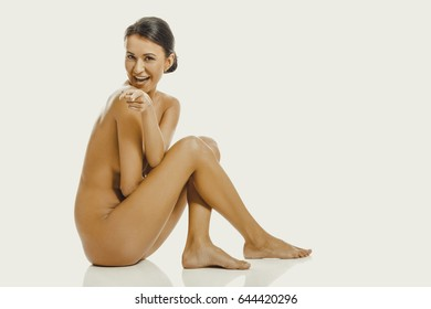 Nude woman pointing on you