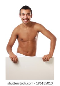 A nude young man covering himself with a towel and standing near blank