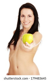 Nude young woman with a green juicy apple, isolated on white background - focused on apple