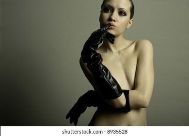 nudel elegant girl with the gloves. Studio fashion photo.