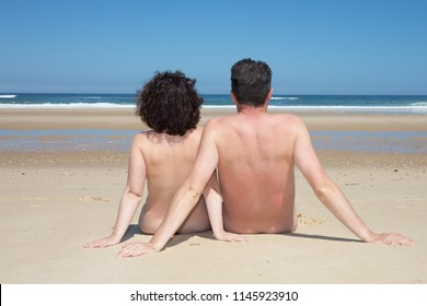 nudism concept for alternative free leisure activity Nudist couple caucasian man and woman naturist