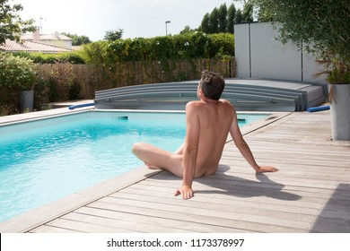 nudism man relaxing vacatioàn in pool side summer in concept of freedom liberty and nudist